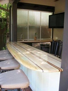 A surfboard bar top that is slick, stylish, and most of all ... super fun!