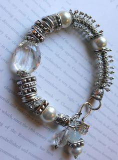 unique handmade bracelet, by Mollie Carey note the unusual metal bead arrangement-looks like space-age 'daisy' beads with rondelle spacers between them-very interesting