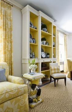 paint the interiors of your living room book shelves yellow!  (or aqua or orange)