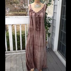 "HIPPIE STRETCH TYE DYE MAXI DRESS This is exactly the same as the pink one listed only it's brown, has the same fringe on front with braided neckline,elasticized back area and it also is a Sz L..measurements: LENGTH:54"" BUST:46 (stretches to) WAIST:28"" stretches to these have never been worn but I dislike with a passion the labels they sew on so I always remove them!! Accessories not included! Dresses Maxi"