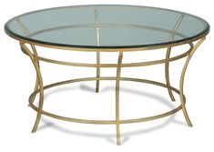 """This round glass top coffee table is 36"""" in diameter and the circle motif is dominant in the details of the iron frame which is finished in an antique gold color. Will fit perfect in any decor. Overall measurements are 36"""" in diameter by 18"""" high. 