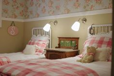Jenny Lind crib used as matching twin head boards- love the floral wall paper with the trim and tan walls (and the gingham and white bedding of course)