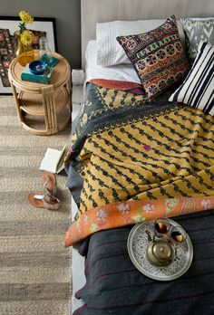 A gorgeous relaxed eclectic bedroom look - vintage kantha quilts, cushions and rattan side table part of the new summer collection online now www.bowerhouse.com.au