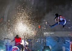 Musicians Josh Dun (L) and Tyler Joseph of Twenty One Pilots perform onstage during the 2016 American Music Awards at Microsoft Theater on November 20, 2016 in Los Angeles, California.