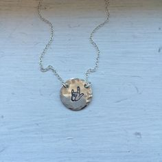 A personal favorite from my Etsy shop https://www.etsy.com/listing/260813047/asl-i-love-you-necklace-sterling-silver