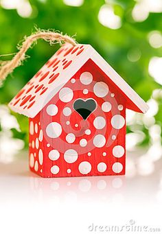 Red birdhouse in white polka dot by Olga Lupol, via Dreamstime