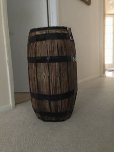 Barrel out of cardboard. Will need brown, black, white paint & black duct tape.