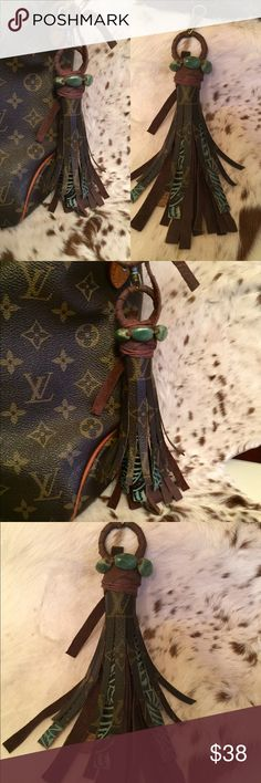 "Authentic upcycled Louis Vuitton Canvas tassel This is a Faith and Fringe tassel that can be used as a keychain or purse charm. It measures 9"" in total length. It was made from authentic Louis Vuitton canvas from a damaged Sac. It has brown leather, teal and brown embossed leather, and stone accent. It has a large clasp.  Contact me for custom orders!! Like us on Facebook Faith and Fringe Louis Vuitton Accessories Key & Card Holders"