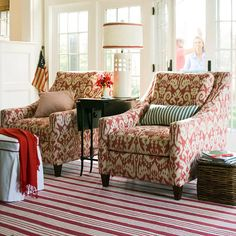 Red, white and a touch of blue! I like the striped rug and the pattern on the chairs.
