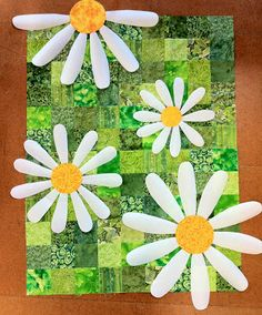 Love the way a simple quilt can change to wow with over sized flowers that run into the border