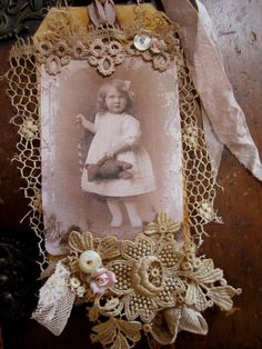 Here is a sweet vintage lace collage embellished hang tag that I have created. I have used the sweetest ever fabric girl vintage image and