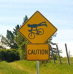 Caution. Superman flying a bike nearby