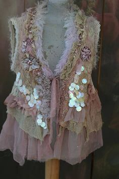 Whimsy hand dyed vintage knit, deconstructed into vest (cotton) in shades of cream, pale sage, oatmeal, pale grays..Reworked with old lace pieces at hems- hand embroidered cotton net with floral motifs, torn/textured/tattered lace, tulle and cotton net at collar, silk and velvet petals