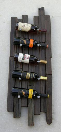 Reclaimed Wood Rustic 5 Bottle Wine Rack Handmade from reclaimed redwood stakes once used to support grape vines in the Napa Valley, this wooden wine rack is a one of a kind rustic gem. A great way to bring California redwood heritage into your home, this Bottle Rack, Wine Bottle Holders, Wine Bottles, Rustic Wine Racks, Wine Cellar, Grape Vines, Wood Projects, Decoration, Handmade