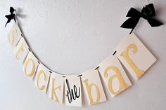 Such a chic party centerpiece for a Stock the Bar themed couple's shower!