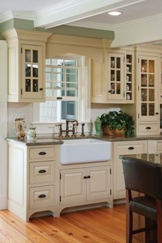 Traditional Island Style Teal kitchen, cream cabinets, Crown Point Cabinetry,