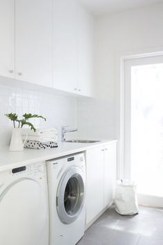 Modern white laundry room features white cabinets paired with white countertops and a white grid tiled backsplash. Modern white laundry room features white cabinets paired with white countertops and a white grid tiled backsplash. White Countertops, Room Design, Laundry Mud Room, Room Layout, Laundry Room Layouts, Stylish Laundry Room, Grey Floor Tiles, Grey Flooring, White Laundry