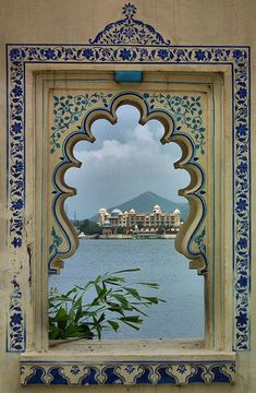 The Palace in the Lake at Udaipur, India -- seen through a traditionally painted window. www.TheTripStudio.com