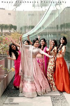 Bride in light pink engagement lehenga , pink and silver engagement lehenga , fun bridesmaid shots , sisters of the bride , pastel lehenga