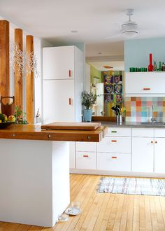 white cabinets with colored drawer pulls