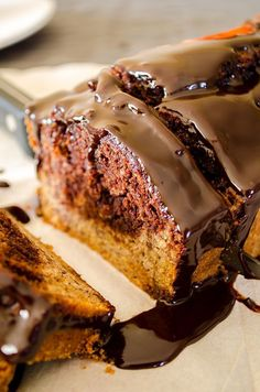 Chocolate marbled banana bread topped with a silky ganache. This is such a light and very moist cake loaded with banana flavor that one slice is never enough!
