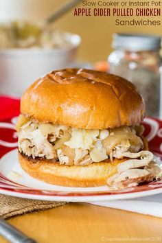 Apple Cider Pulled Chicken Sandwiches that you can make in your slow cooker or Instant Pot are an easy fall dinner the family will love. Pile the shredded chicken, apples, and onions on bread or rolls and top with cheese. #slowcooker #chickenrecipes #instantpot Pulled Chicken Sandwiches, Wrap Sandwiches, Beste Burger, Fall Dinner, Shredded Chicken, Pressure Cooker Recipes, Apple Cider, Wraps, Crockpot Recipes