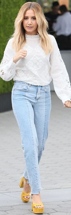 Who made  Ashley Tisdale's blue jeans and white lace top?