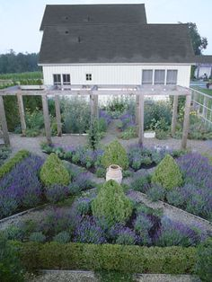 "Formal doesn't have to mean difficult. This parterre lends elegance and a sense of order to the property's vast acreage. Composed of only two types of plants—lavender and boxwood—it's also easy to tend. ""We do all the work ourselves, so we needed a fairly low-maintenance garden,"" explains Dannielle. ""The secret is to choose plants that naturally keep themselves tidy, then plant densely."""