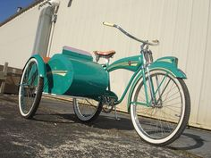 I would ride this to the grocery store... the boys would disown me but that's okay...  LOVE IT!  Firestone bicycle with a side car.