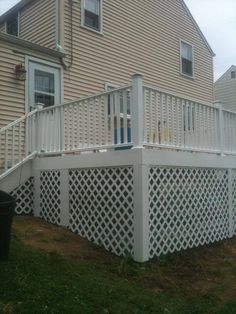 Rebuilt deck in Stratford, CT with vinyl railings and lattice; wrapped with pvc trim.