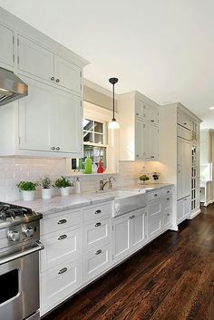 love the dark floors against the white cabinets