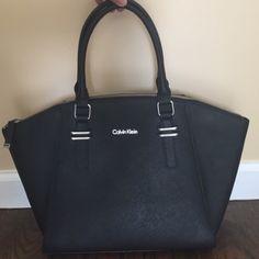 New Calvin Klein bag New, nice Calvin Klein bag. 1 big & 3 small pockets inside.(I can use Merc app) Calvin Klein Bags