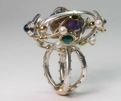 Claudio Pino - kinetic ring 'magnificence stellaire' - gold, silver, black opal, chrome diopsides, emerald, moonstones, pearls (EXPO Aaron Faber, NY)----wildly crazy...I love it!