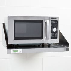 """This 24"""" x 18"""" microwave shelf offers a unique combination of affordability and durability with its 18-gauge type 430 stainless steel construction. This microwave wall shelf is ideal for maximizing storage space above stoves, sinks, and other kitchen equipment and has a maximum capacity of 140 lb. Simply mount your microwave shelf to any wall using L brackets and place your microwave on top; it's as easy as that! Now you can marvel at the extra countertop space you have…"""