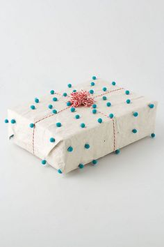 gift wrap idea.... bakers twine and pom-poms- use on brown packing paper.