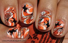 Wet n Wild French White Creme,  marbled using Sally Hansen Xtreme Wear White On, Sally Hansen Xtreme Wear Sun Kissed, and China Glaze Life Preserver, stamped using BM 13 in Konad Black. (halloween)