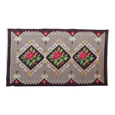 VINTAGE KILIM RUG with a floral pattern //N55   Moldavian kilim rugs, wrongly called Bessarabian kilims rugs, are famous for their vivid flower patterns. Each village has its own patterns but styles can roughly be separated into northern and southern.The difference is in the rug's background pattern. The south style kilim rugs usually have a black background without any pattern, sometimes ivory, while the north style kilim rugs have geometric patterns on the background. They are alw...