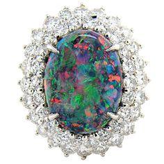Lighting Ridge Black Opal surrounded by diamonds and set in platinum. Jewelry Art, Gemstone Jewelry, Antique Jewelry, Beaded Jewelry, Jewelry Rings, Jewelery, Vintage Jewelry, Fine Jewelry, My Birthstone