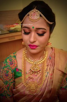 Amitha looks gorgeous for her muhurtam in traditional bridal silk saree and jewellery. Makeup and hairstyle by Vejetha for Swank Studio. Winged eyeliner. Pink lips. Maang tikka. South Indian bride. Eye makeup. Bridal jewelry. Bridal hair. Silk sari. Bridal Saree Blouse Design. Indian Bridal Makeup. Indian Bride. Gold Jewellery. Statement Blouse. Tamil bride. Telugu bride. Kannada bride. Hindu bride. Malayalee bride. Find us at https://www.facebook.com/SwankStudioBangalore