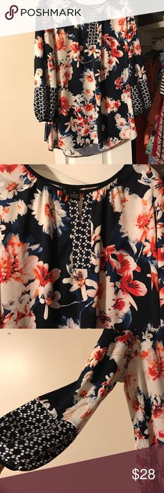 Gorgeous blouse! NWOT Blue w/ white flowers This blouse really is gorgeous! It is so soft and the colors are beautiful. You will not regret this purchase. Wear with a great pair of white linen pants or jeans.                            Smoke free home. Reasonable offers welcome. Closet 126 new directions Tops Blouses