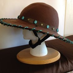 One-of-a-Kind fashionable safety helmet cover designed for the rider participating in Western Pleasure Shows, Western Dressage, and Trail Riding.