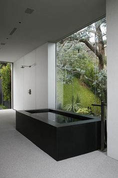 Concrete and glass home immersed on a cliff