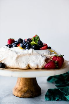 Pavlova is crisp on the edges, chewy on top, and marshmallow soft and creamy in the centers. Pile high with lemon curd, whipped cream, and fresh fruit to make a naturally delicious gluten free dessert!