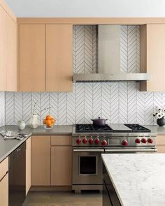 LOVE this backsplash (and the stove, of course)! There's nothing like dark grey grout to bring out the drama in your kitchen. A chevron backsplash works, too. Oh also Gordon Ramsey but… Install Backsplash, Paint Backsplash, Rustic Backsplash, Hexagon Backsplash, Blue Backsplash, Beadboard Backsplash, Stone Backsplash, Herringbone Backsplash, Kitchen Backsplash