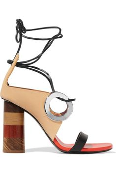 Wooden heel measures approximately 100mm/ 4 inches Beige and black leather Ties at ankle Made in Italy