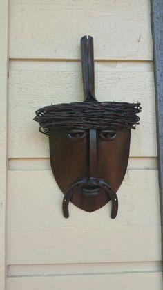 Metal sculpture shovel face