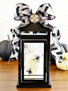 Get glam this Halloween! More ideas here: http://www.bhg.com/halloween/indoor-decorating/easy-halloween-mantel-ideas/?socsrc=bhgpin092814lanternmanteltopper&page=6