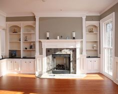 fireplace with bookshelves - stone tile with decorative inserts