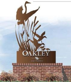 The new Oakley sign will feature a long, short brick with a monolith bronze…