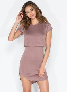 The Amada Mini Dress is top and bottom in one, and neither will ever try to leave you. Stretchy, lightweight, short-sleeved minidress features a rounded hem that is shortest on the sides and an attached boxy top with a kangaroo pocket for a two-piece look.